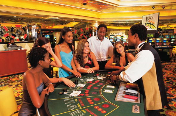 Guests playing a hand of black jack at the Sun City Casino.